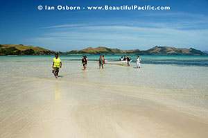 backpackers arriving at long beach resort in the fiji islands