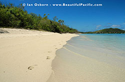 Backpacker footprints along Long Beach in the Yasawa Islands
