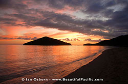 Backpackers enjoy beautiful sunsets from Long Beach Resort Fiji