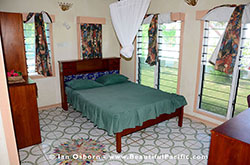 Superior Cottage at Long Beach showing double bed